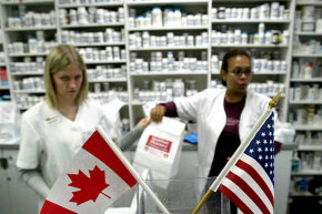 Canadian and American flags fly as Canadian pharmacists handle prescription drugs for a group of Minnesota senior citizens in 2003. Even though it is now technically illegal, many still Americans drive to Canada to buy cheaper drugs.