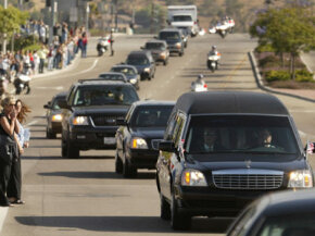 Mourners line the road in Camarillo, Calif., as the hearse carrying former President Ronald Reagan's casket passes on June 9, 2004.