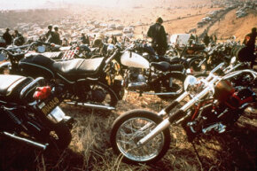 """Motorcycles crowd the field at the infamous """"Gimme Shelter"""" rock concert featuring the Rolling Stones. A fan was stabbed to death by a member of the Hells Angels motorcycle club on Dec. 8, 1969, at the Altamont Speedway in Livermore, Calif."""