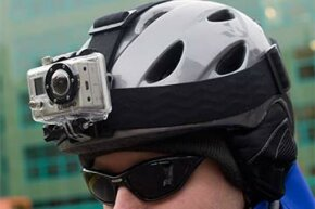 A man wears a ski helmet with the GoPro camera attached to it.