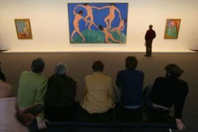 "Visitors look at Matisse's ""Dance"" at a Museum of Modern Art exhibit in Berlin."