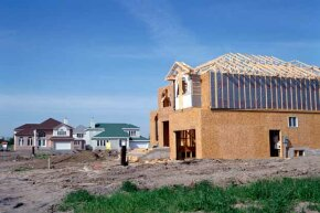 The ground around the foundation should slope slightly away from the house to keep water away from it.