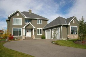 To keep your driveway looking as pristine as this one, scrub it down and apply a sealer.