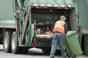 All in a day's work: a garbage collector cleans up our streets.