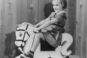 The rocking horse wasn't all play — riding horses was a skill many kids would eventually have to learn.