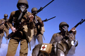 U.S. Army soldiers in California, rifles in hand, wear gas masks during a 1943 training exercise related to chemical attacks. As warfare has become more complex, so have the injuries medics must treat on the battlefield.