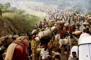 Rwandese refugees cross the border into Tanzania in 1994.