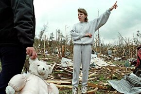 A woman stands amid rubble in the wake of a 1998 tornado that tore through Harvest, Alabama -- one of four to hit the town between 1974 and 2012.