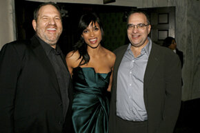 "Filmmaker Michael Moore sued Harvey Weinstein (left) and his brother Bob Weinstein (right) over profits of the film ""Fahrenheit 9/11."""