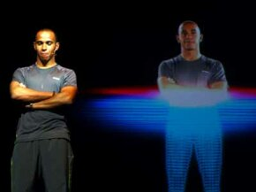 Formula 1 driver Lewis Hamilton of Great Britain stands next to a 3D hologram during the Reebok launch of their new Smooth Fit technology.