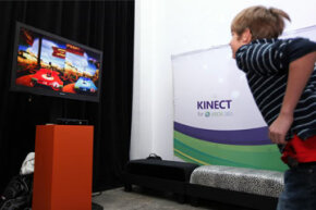 While the Microsoft Kinect offers three-dimensional game play movement, it doesn't project imagery out to the player's environment.