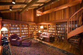 This lucky person has lots of room for a home library that incorporates built-in bookshelves, comfy seating and ample light.