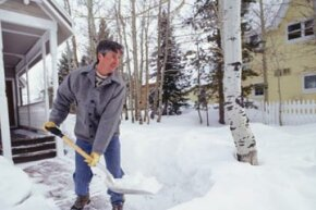Here's what winter at home more likely resembles: shoveling snow from your front door.