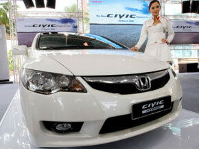 Models present the new Honda Civic Hybrid car at its launch in Kuala Lumpur, Malaysia, on March 19, 2009.