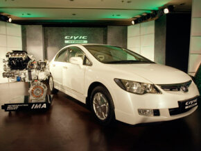 A Honda Civic Hybrid car and its displayed engine, left, are seen at an event in New Delhi, India, on June 18, 2008.