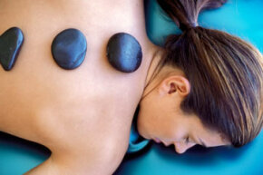 Hot stone therapy can increase joint flexibility, among other benefits.