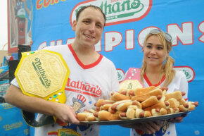 2014 winners Joey Chestnut (Men's Division, 61 hot dogs in 10 minutes) and Miki Sudo (Women's Division, 34 hot dogs in 10 minutes) at the annual Nathan's International Hot Dog Eating Contest in New York.