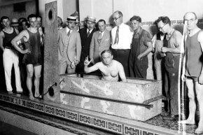 Harry Houdini prepares for a coffin escape stunt in 1926.