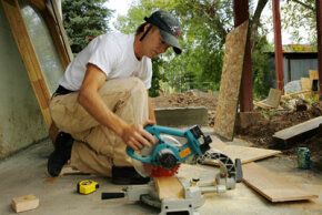 One of the biggest questions when flipping a house: Do I hire help or do it all myself?
