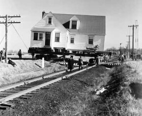 Moving a house over obstacles such as railroad tracks can add significantly to the costs.