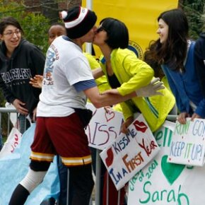 A Wellesley college girl gets a kiss from a runner as the race passes through Wellesley, Mass., during the 114th running of the Boston Marathon.