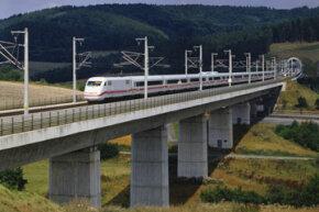 A train speeds over a beam bridge.