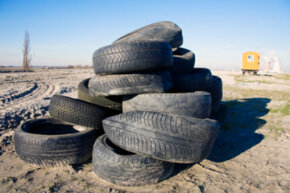 A discarded pile of used tires on a construction yard