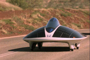 The Honda Dream solar car races through Australia as part of the World Solar Challenge.
