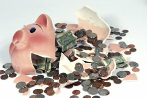 When it comes down to breaking open the piggy bank, it's time to figure out just how much it takes to live on. See more banking pictures.