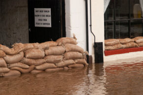 Sandbags protecting a business from floodwaters in England.