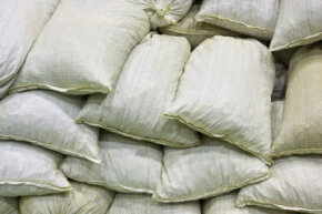 Sandbags stacked in a pyramid formation.