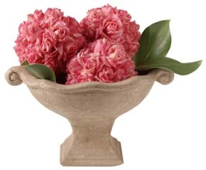 Place one type of flower into a favorite container for an informal arrangement.