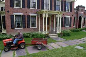 Joe Tomaino heads home on his lawn tractor after conducting his banking business at the First National Bank of Orwell in Orwell, Vt.