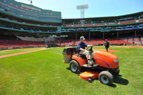 Jason Griffith mows the infield at Fenway Park in Boston, Mass.