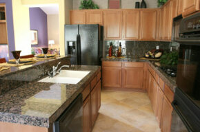A refacing job can give you lovely, new-looking cabinets like these. See more pictures of kitchen decor.