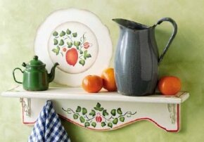 The supporting shelf is real, but the eye-catching plate is a stencil.