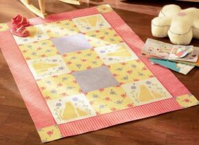 This cute cat-inspired floorcloth                                  showcases your stenciling skill.