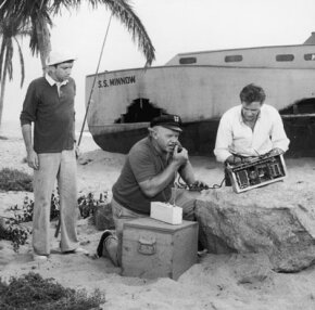 Gilligan, the Skipper and the Professor attempt to use a CB radio in front of their shipwrecked SS Minnow on 'Gilligan's Island.' See more beach pictures.