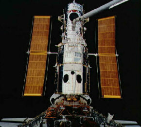 The Hubble Space Telescope is deployed from the cargo bay of the space shuttle. To learn more about Hubble, visit the Discovery Channel. See more Hubble Space Telescope pictures.