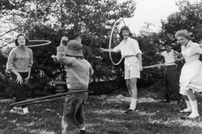 Hula hoop fever grips a 1950s family.