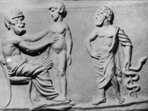 A cast taken from an ancient Greek intaglio gem depicts a physician examining a patient while Asclepius, the god of healing, stands nearby holding the symbol of medicine, a snake coiled round a staff.