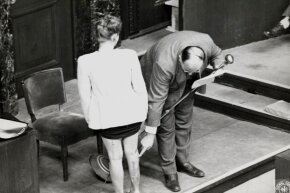 A Polish witness and a doctor show the wounds the woman received from Nazi experiments during the trial of 23 Nazi doctors in Nuremberg, Germany in 1946.