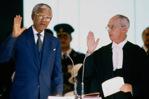 Nelson Mandela being sworn in as the first democratically elected President of South Africa in 1994.