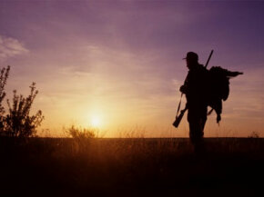Turkey hunter at sunrise near Ballinger, Texas.