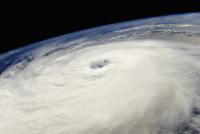 Hurricane Hellene, seen here in a photo captured from aboard a 2006 space shuttle mission, rages through the Earth's atmosphere. See more storm pictures.