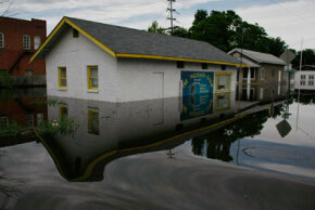A business is surrounded by flood water from the Mississippi River in Foley, Mo.