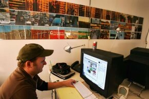 Web designer Doug McLaughlin works on the American Apparel garment factory Web site in Los Angeles. The IAHC attempted to reclassify such Web sites in the 1990s.