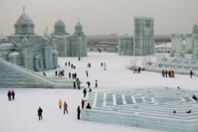 The Harbin International Ice and Snow Festival by day may not have all of the evening light effects to illuminate the ice, but it's still dazzling.