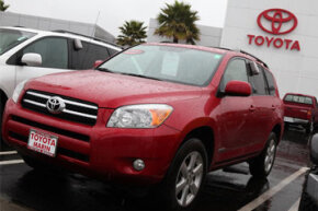 A brand new Toyota RAV4 is displayed on the Toyota of Marin sales lot in San Rafael, Calif.