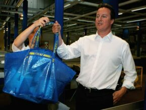 Conservative Party leader David Cameron shows off his reusable Ikea shopping bag.